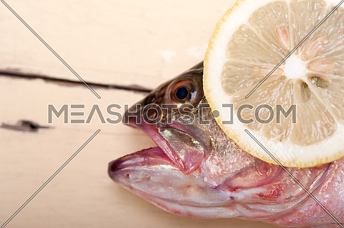 fresh whole raw fish on a wooden table ready to cook