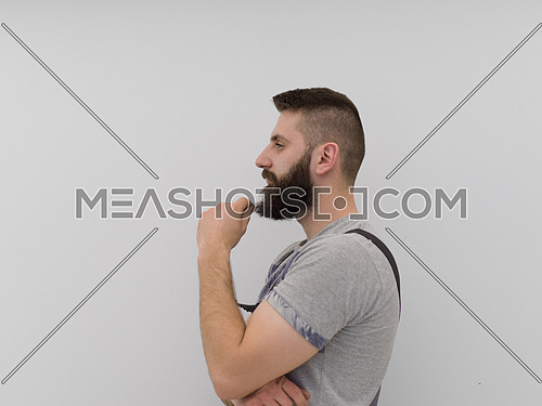 portrait of  young bearded hipster handyman isolated on white background