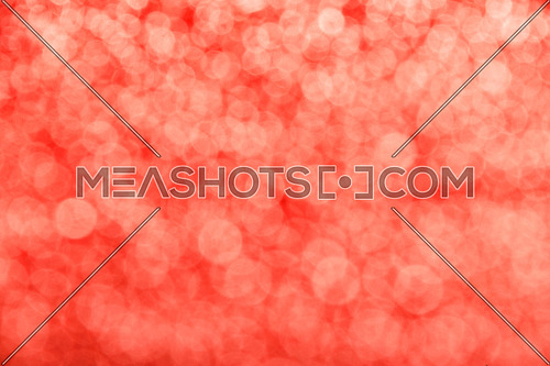 Coral red festive glitter tender bright magic light circles abstract blur effect background
