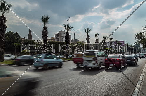Track Right Shot for traffic at Salah Salim Street showing Le Baron Palace in background at Daytime