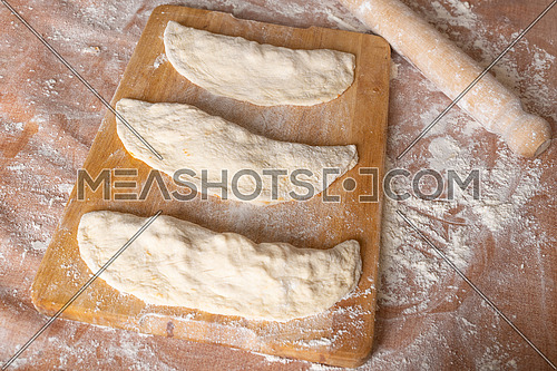 Making dough on brown table background,view from above.