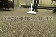 A person is using a vacuum cleaner