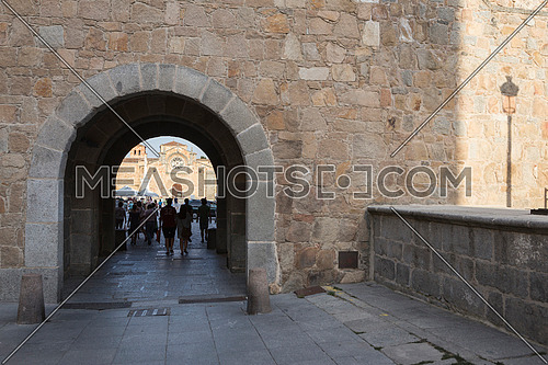 Avila, SPAIN - 10 august 2015: Santa Teresa Square, Front of the Church of San Pedro, Tourists strolling through the arc of the walls of Avila, Spain
