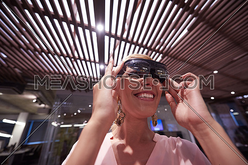 young woman using virtual reality gadget computer technology glasses