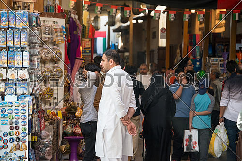 tourists and sellers at the grand bazzar in Dubai, UAE