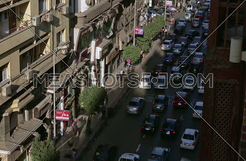 Fixed high angel Shot for Traffic at Talat Harb Street at Cairo at Day