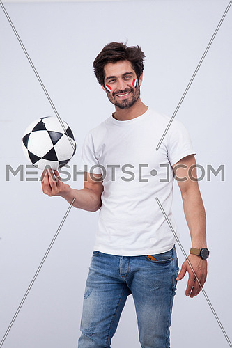 a  young man with a white t-shirt holding football on a white background
