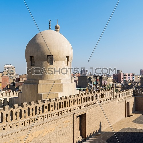 Fence of Ibn Tulun Mosque revealing dome of Amir Sarghatmish mosque, Sayyida Zaynab district, Medieval Cairo, Egypt