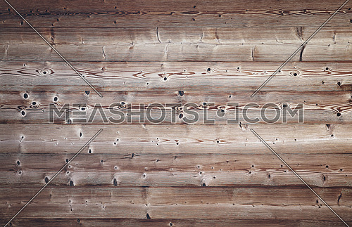 Close up background texture of old vintage brown weathered horizontal knotted wooden planks