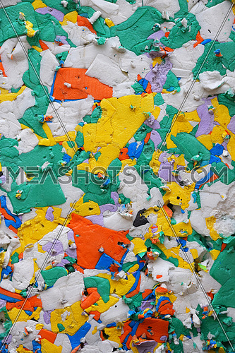 Multicolor pressed polystyrene recycled panel of different pieces utilized for construction and packaging