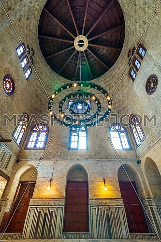 Interior shot of a hall at Mamluk era Sultan al Ghuri Mausoleum with decorated marble floor, stained glass windows, and bricks stone wall, Cairo, Egypt