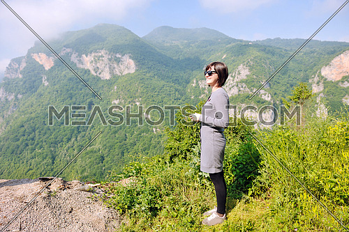 portrait of happy young  woman in nature