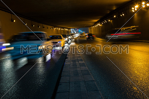 Long Shot for traffic from inside  Al Thawra Tunnel at Night