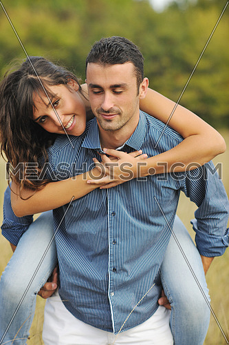 happy young couple have romantic time outdoor while smiling and hug