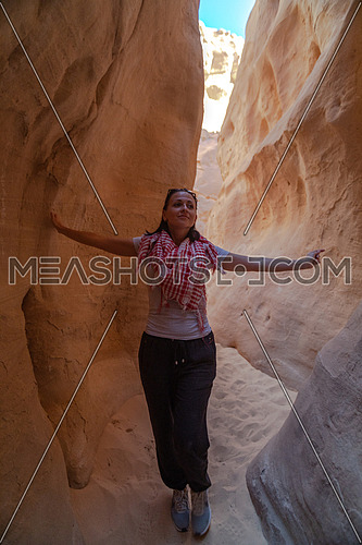 Female Tourist inside Makhroum Mountain in Sinai Trail by day