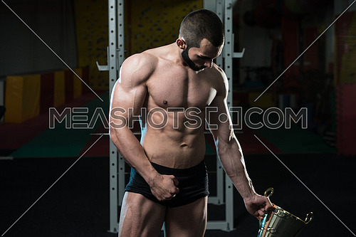 Bodybuilder Competitor Showing His Winning Medal - Male Fitness Competitor Showing His Winning Medal