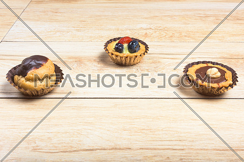 three italian Pastries close-up wood background