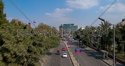 Drone Shot flying beside Cairo Opera House towards Saad Zaghloul Statue showing Qasr Al Nile Bridge and Nile Ritz Carlton Hotel in background at day time