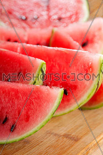 fresh ripe watermelon sliced on a  wood table