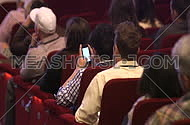 man using his phone during conference