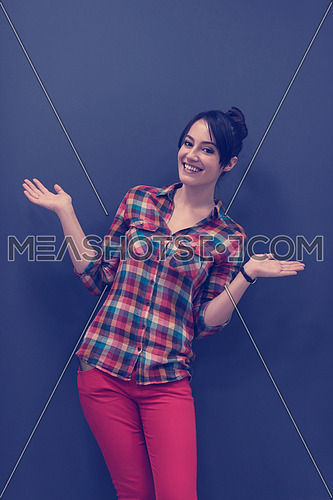 portrait of young startup business woman at modern office, grey chalkboard wall in background