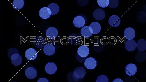 Blue festive Christmas lights circular bokeh over dark, shake tremble moving abstract background
