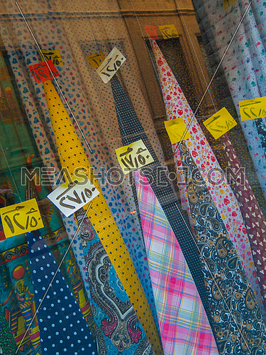 Colorful cloth for sale in a shop window prices in arabic