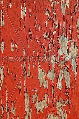Close up background texture of red vintage weathered wooden rustic style wall with flakesof paint