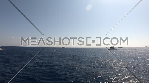 Long shot for the sea from boat showing yachts at day