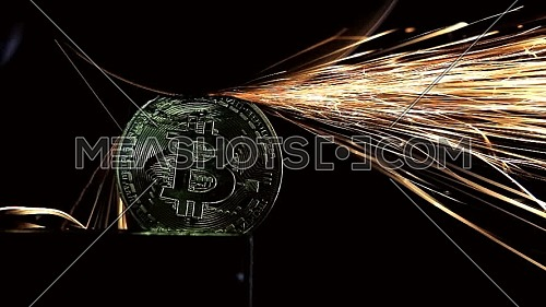 Electric wheel grinding on Bitcoin on black background.