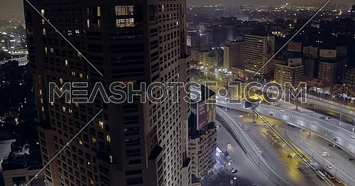 360 Drone shot for Hilton Hotel Showing Abd Elmonan Reyad Bus Station at Tahrir Area in cairo at night