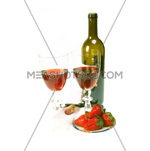 opened red wine bottle and two glasses and fresh strawberries isolated on white