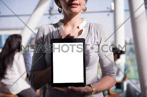 business woman at office  holding tablet computer with empty screen