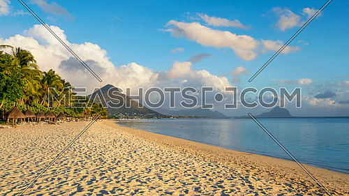 Flic and flac beach in the sunny day,Nice view of mountains, Mauritius island.