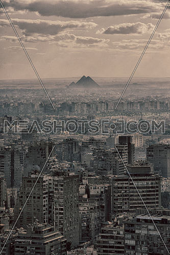 aerial view of Giza city downtown with Nile and pyramids in the distance at beautiful sunny day with blue sky and clouds capital of Egypt