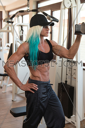Good Looking And Attractive Middle Aged Woman With Muscular Body Relaxing In Gym