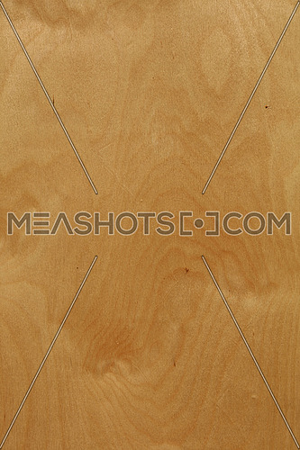 Rough unpainted beige plywood wood grain background texture close up
