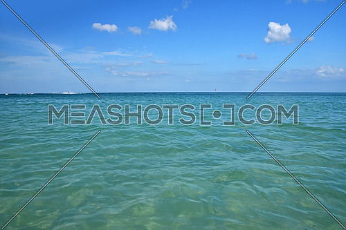 Tranquil seascape of blue sea water and clear sky with horizon, summer day, low angle view