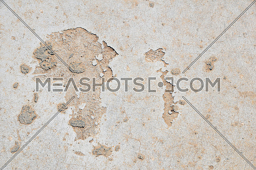 Africa shaped damage fault defects in grunge concrete wall or floor with stains background