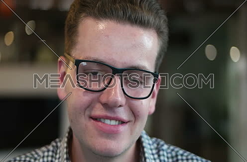 portrait of young businessman at startup office