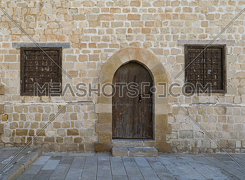 Door and two windows of one of the rooms surrounding the main yard of the citadel of Alexandria (Kayetbay), Egypt
