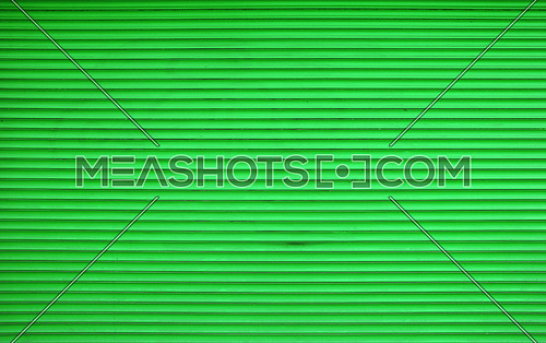 Vivid green painted horizontal metal window roller shutter blinds or garage doors background texture