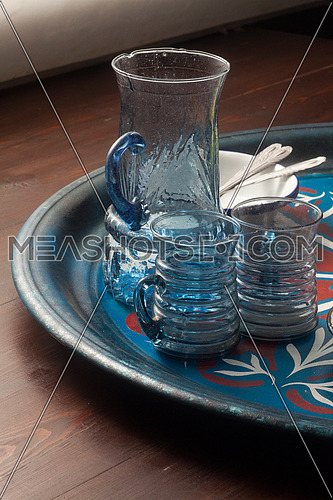 A set of Egyptian handmade glass ware on an oriental tray