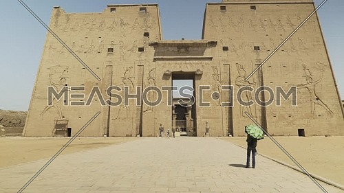 Track out for main entrance Temple of Edfu Egypt by day