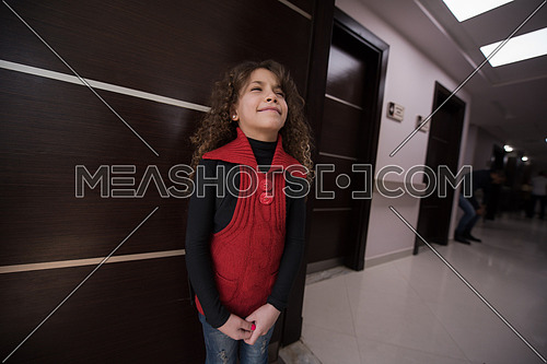 little middle east beautiful child in the waiting room at a modern clinic