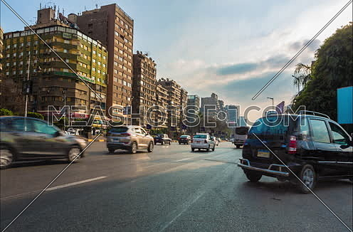 fixed Low angel shot for traffic in Gamet Al Dowal Street at Cairo at Day