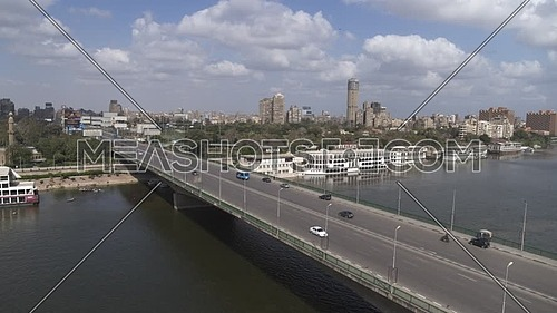 Aerial shot flying over Cairo Downtown empty streets showing 6th of October Bridge and The River Nile during the corona pandemic lockdown by day 10 April 2020