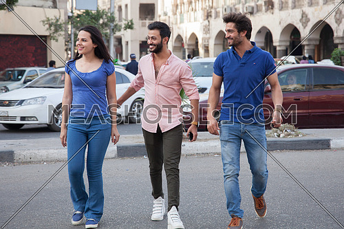 A group of friends crossing the street in Cairo Egypt