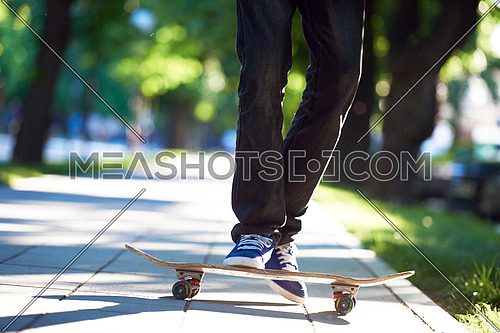 urban scene, closeup of skateboard jump