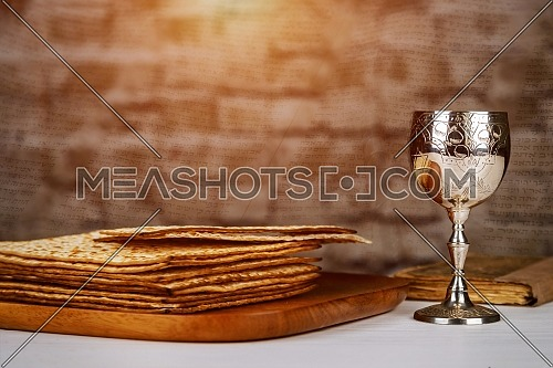 Passover holiday Jewish symbols the with wine and matzoh over rustic background